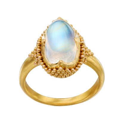 Oval blue moonstone cabachon ring in granulated 22k yellow gold.