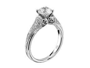 White gold and diamond Cathedral style solitaire engagement ring