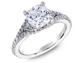 Platinum engagement ring with diamond shoulders