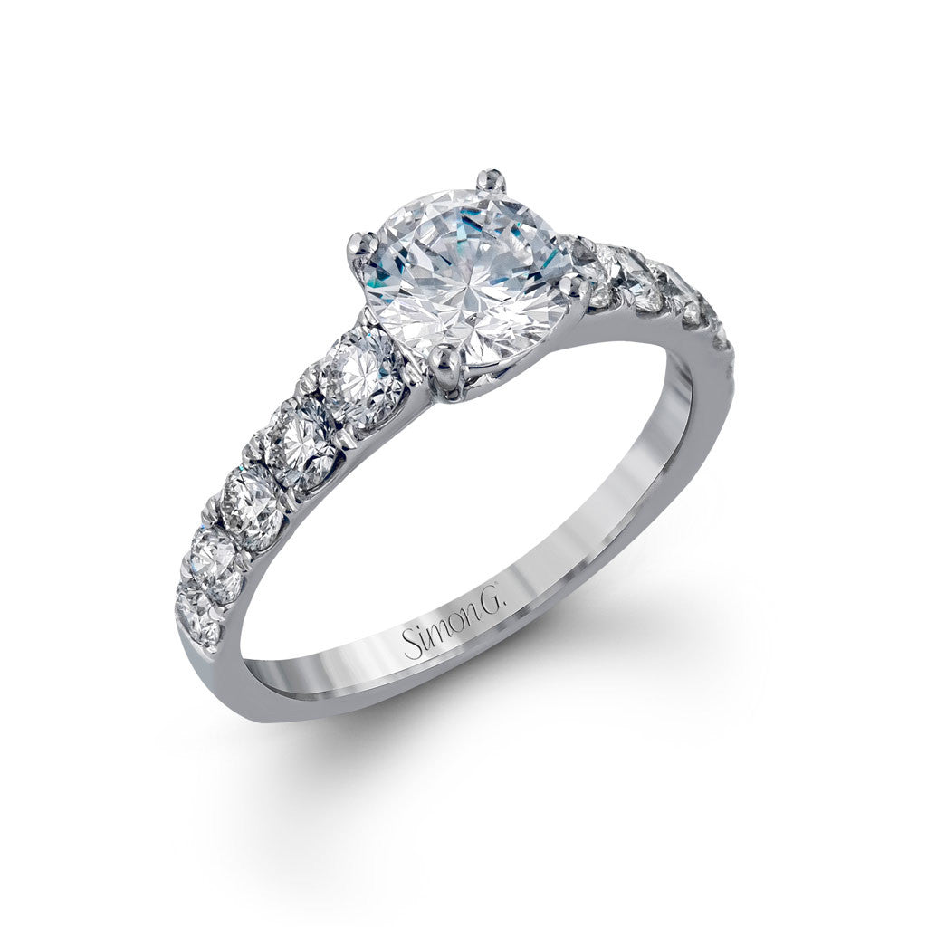 Solitaire Engagement Ring with Diamond Shoulders.