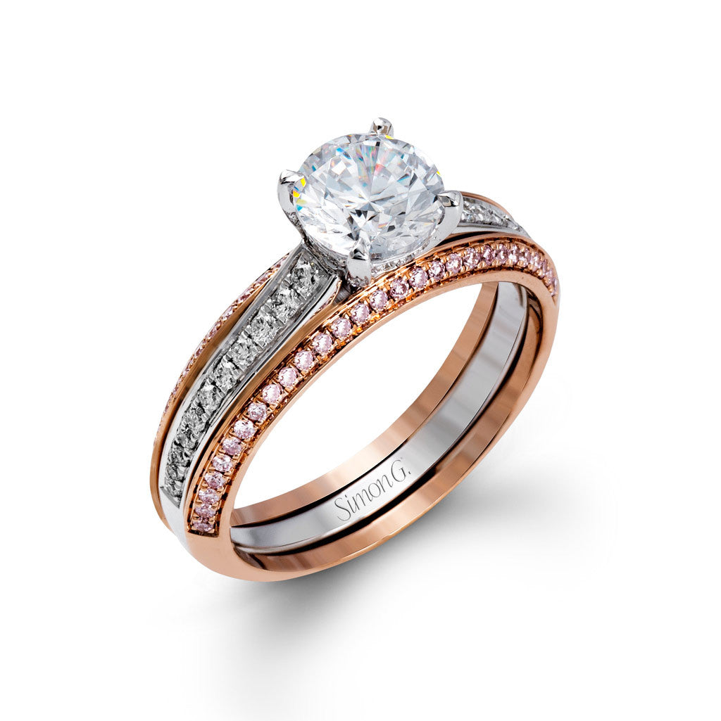 Two-tone engagement ring with rails of pink diamonds set in pink gold