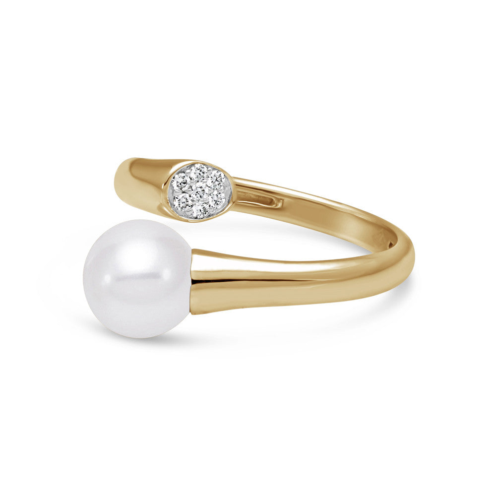 Dramatic pearl and gold ring with diamond accent.