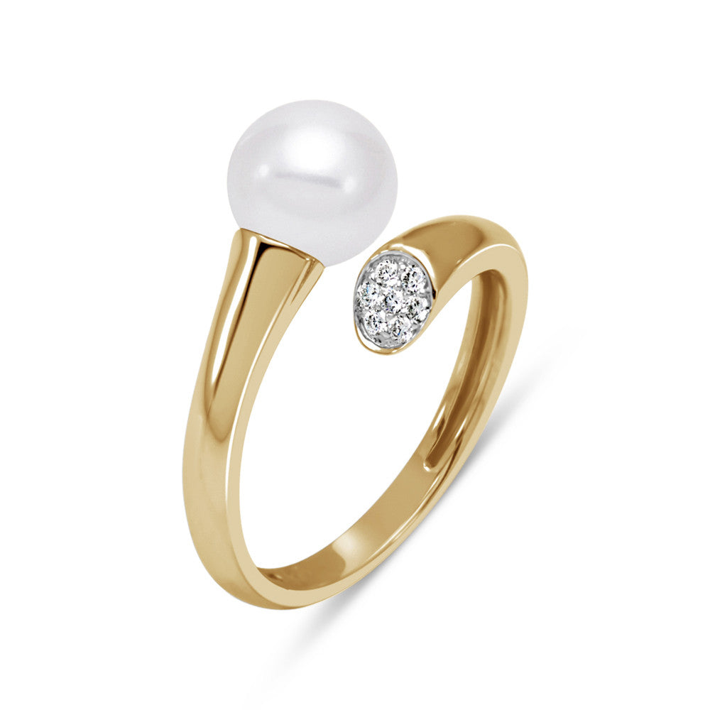 A modern twist of a pearl ring in yellow gold with diamond accents.
