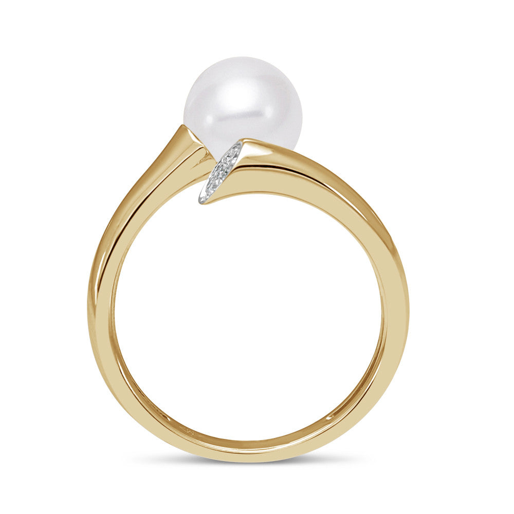 Dynamic modern yellow gold and pearl ring with diamond accents.