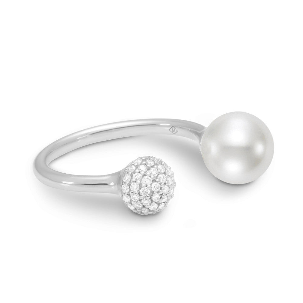 A brilliant white pearl and diamond pave ball center this very modern ring.
