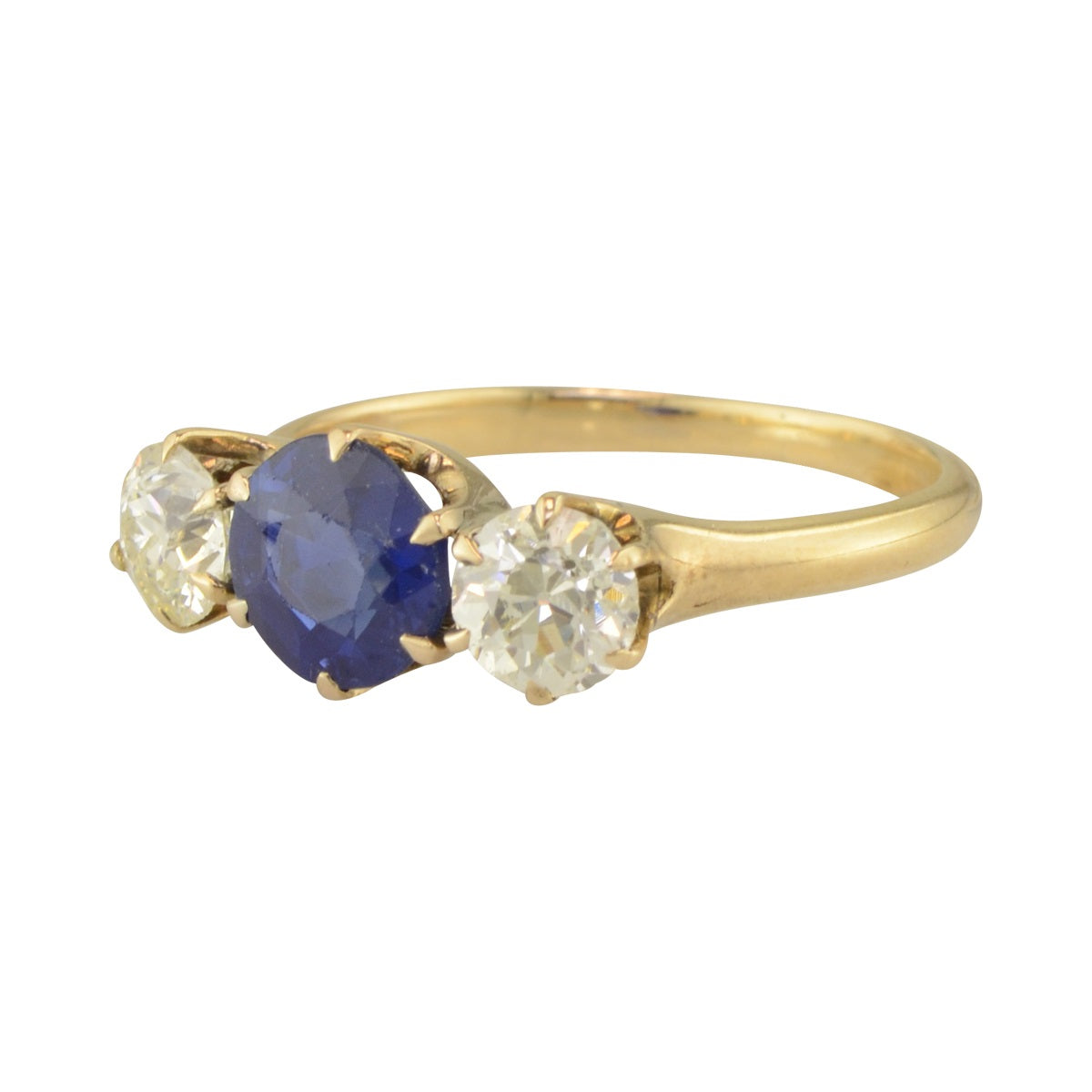 Three stone antique engagement ring with sapphire and diamond in 14k yellow gold.