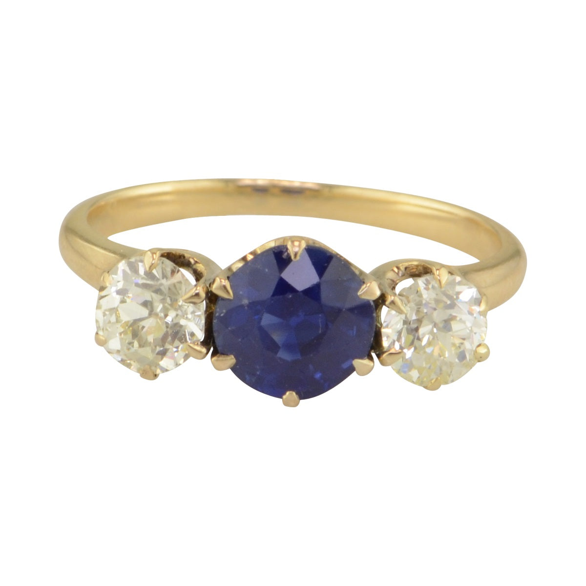 Tryon Creek three stone engagement ring with sapphire and diamond.