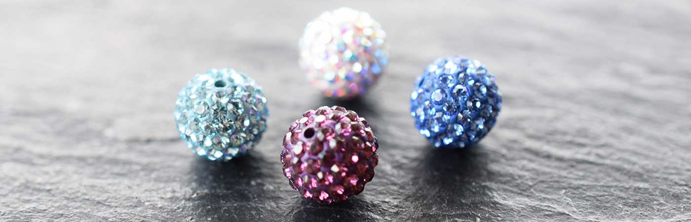 Swarovski becharmed and pave balls and rings