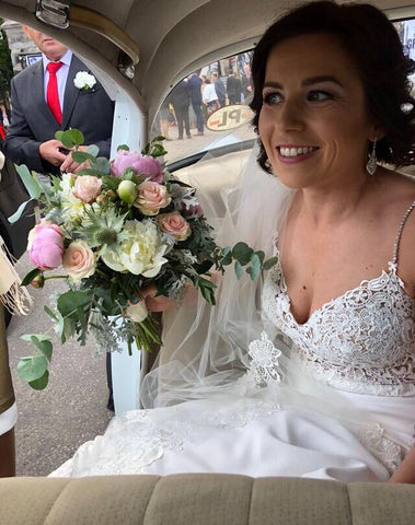 real bride wears tulip earrings