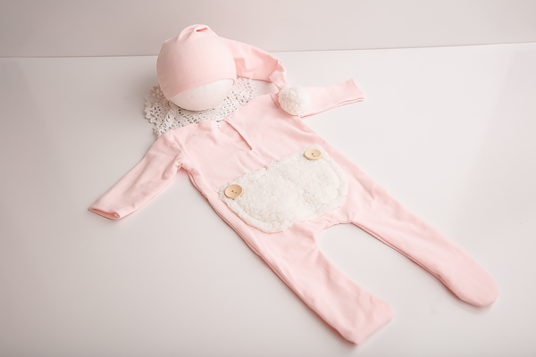 Baby pink romper and beanie set