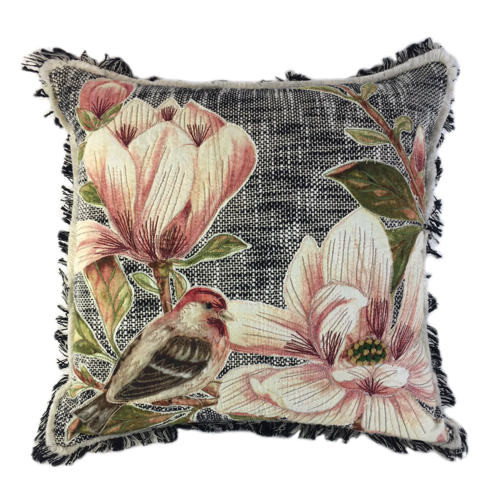 Bird resting on pink Magnolias pillow