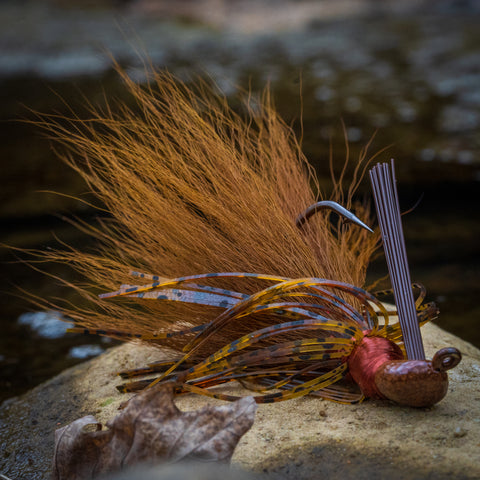 An NCB Hybrid-Skirt Football Jig in Chartreuse pattern