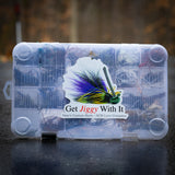 "A Junebug ""Get Jiggy With It"" decal on a plano tackle box"