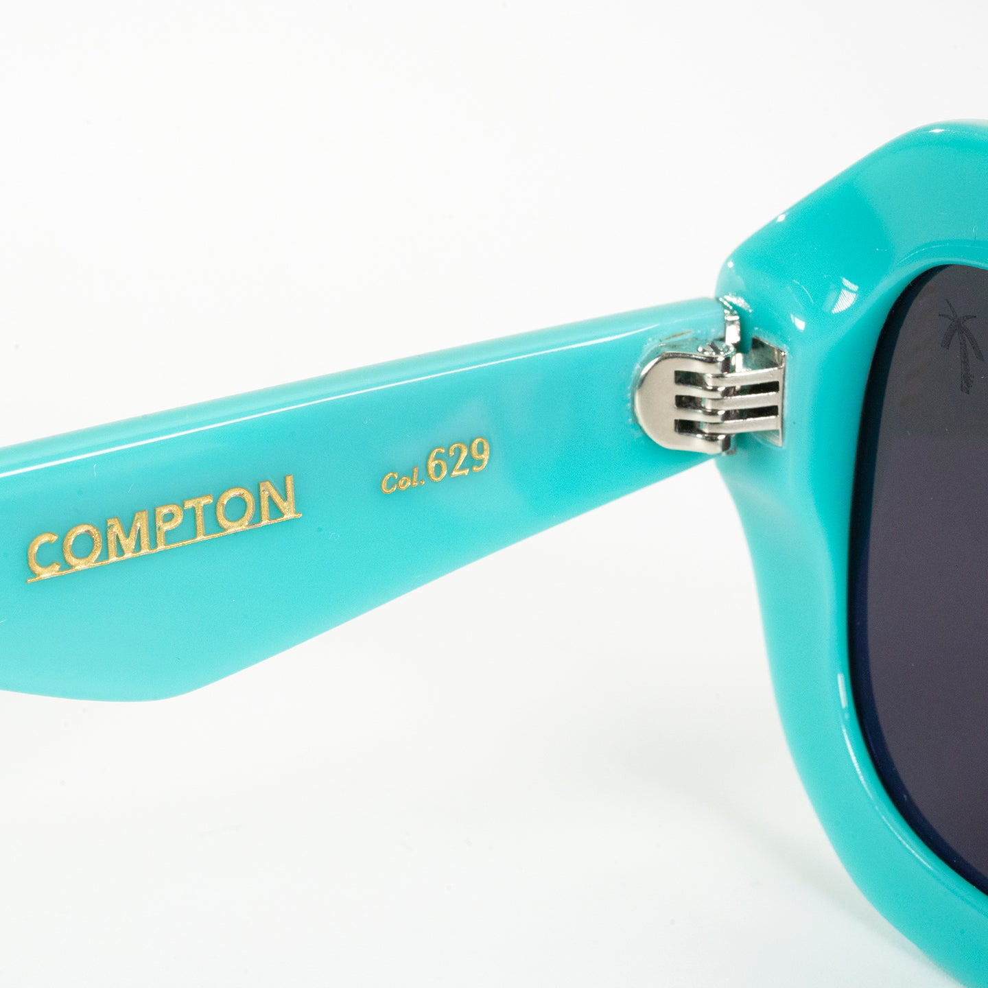 COMPTON in Teal