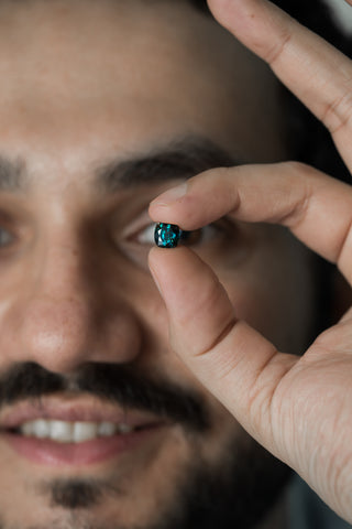 Here is Navneet in a very Nomad's like picture with one of his prized teal sapphires