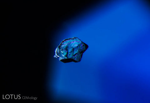 This corroded crystal guest in a Burmese sapphire represents a protogenetic inclusion, one that existed before the sapphire itself.