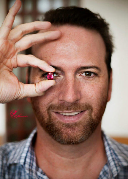 Josh Saltzman from Nomad's Holding one of their lovely pink spinels