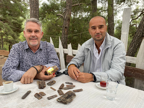 Here is Ian with Murat in Turkey playing with rough Csarite / Diaspore crystals