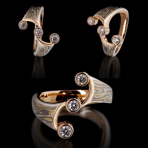 here is an example of fine assymetric jewellery ring made out of mokumegane