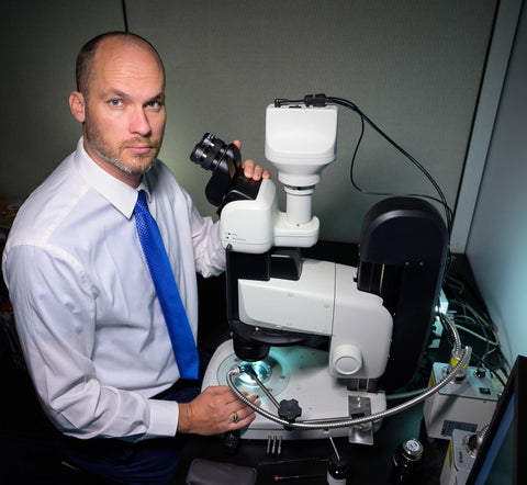 Nathan Renfro working with a Nikon SMZ25 microscope system. Photo by Kevin Schumacher, copyright/GIA