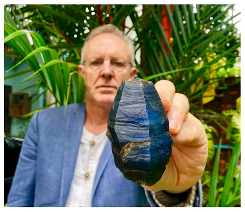 Jeff's holding a rather serious looking rough blue sapphire