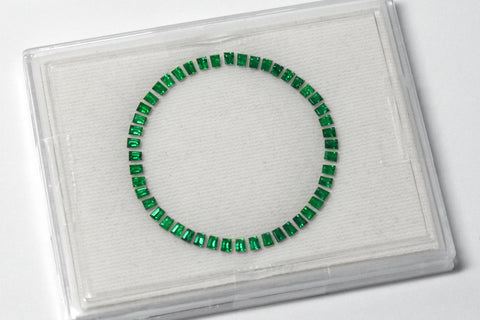 The final product of Swiss cutting, a perfect emerald ring that can be set around a watch dial.