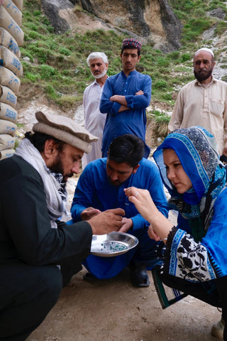 Here is Zoe Michelou inspecting a days worth of emerald production in Swat Valley, Pakistan