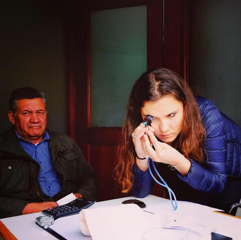Here is Zoe Michelou looking at some fine emeralds in Colombia