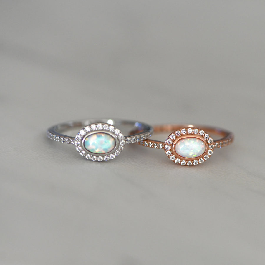 silver and rose gold oval opal ring