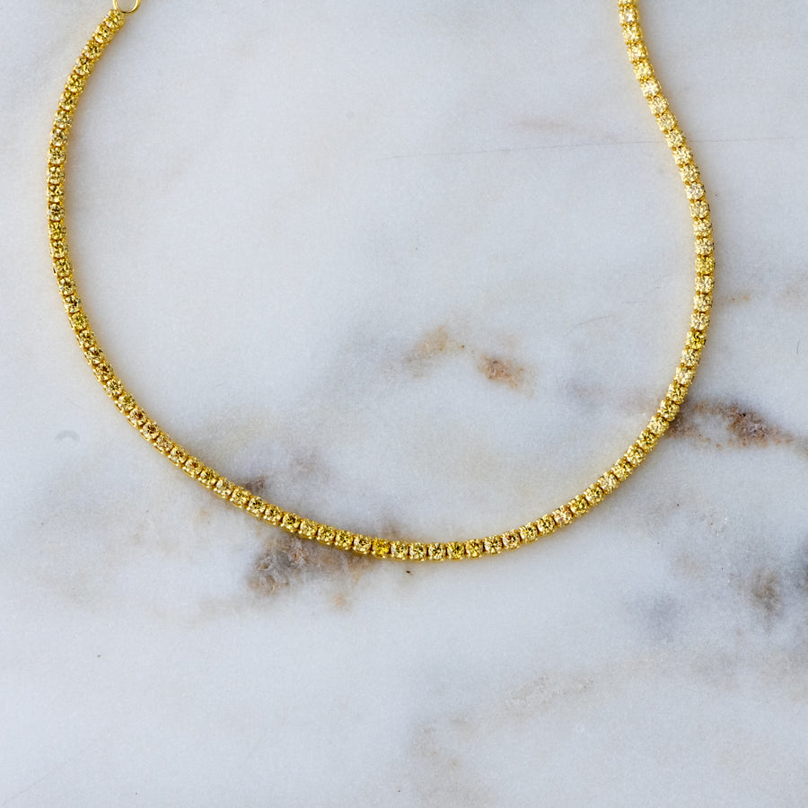 gold anklet with yellow stones