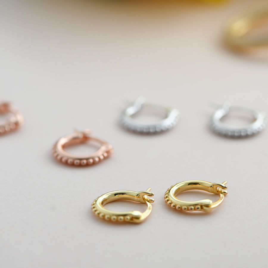small gold hoops with small balls