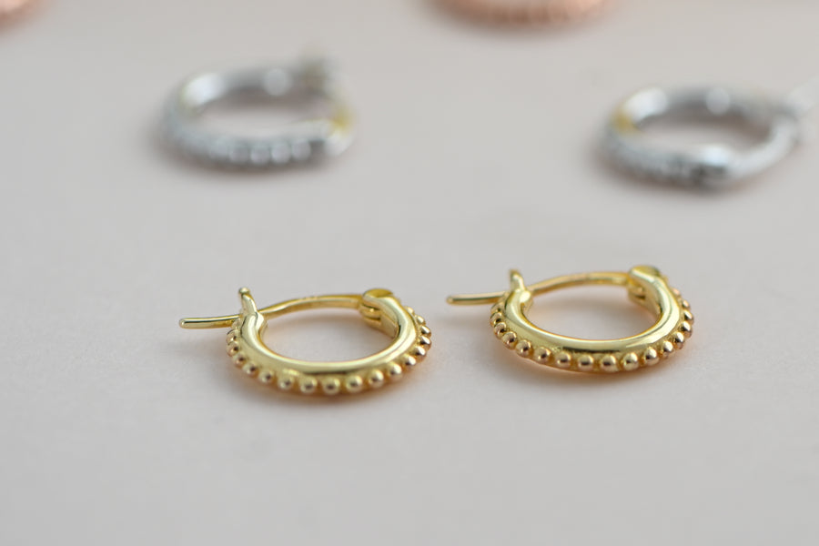 small, gold, beaded huggie hoop earrings with latch back closure