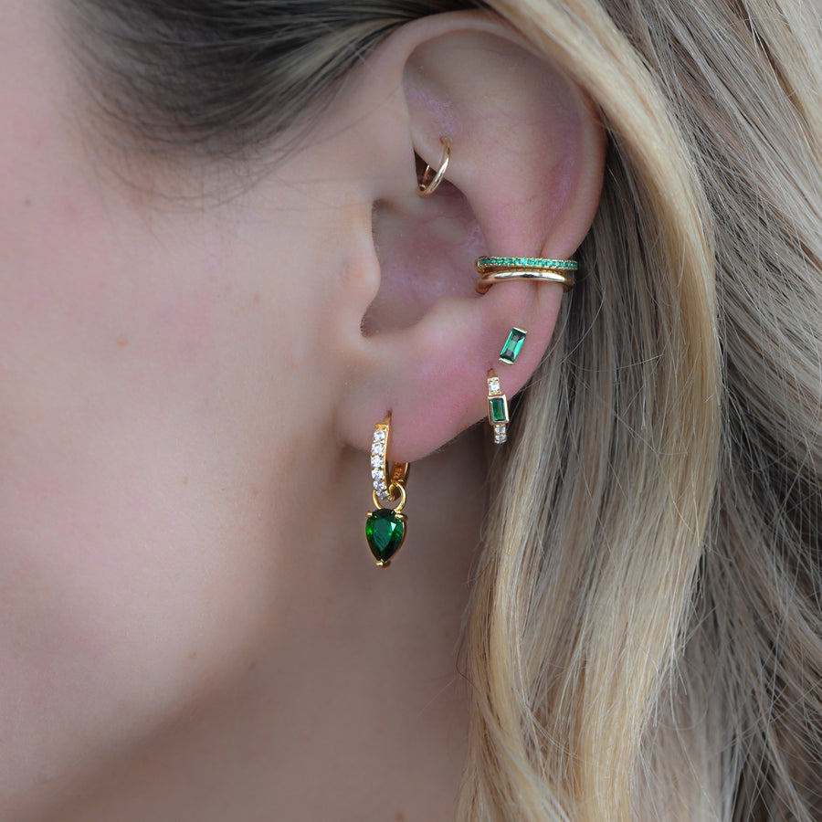 emerald gold tear drop earrings paired with emerald baguette huggies and stud