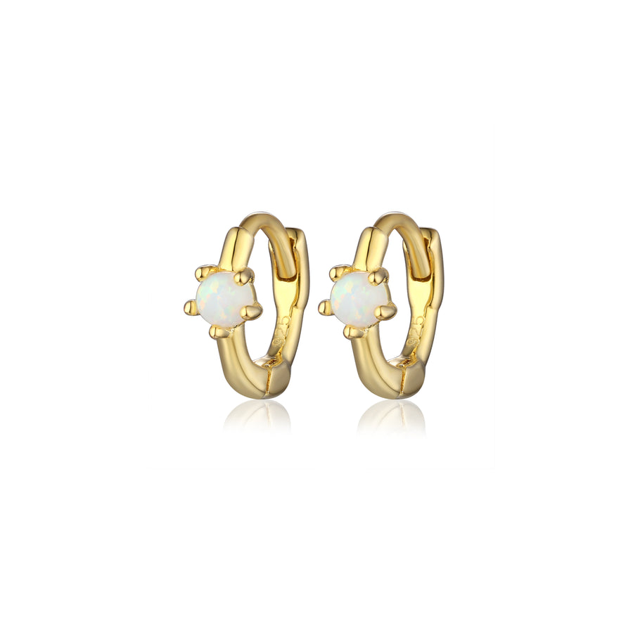 pair of gold small hoop earrings with a opal center stone