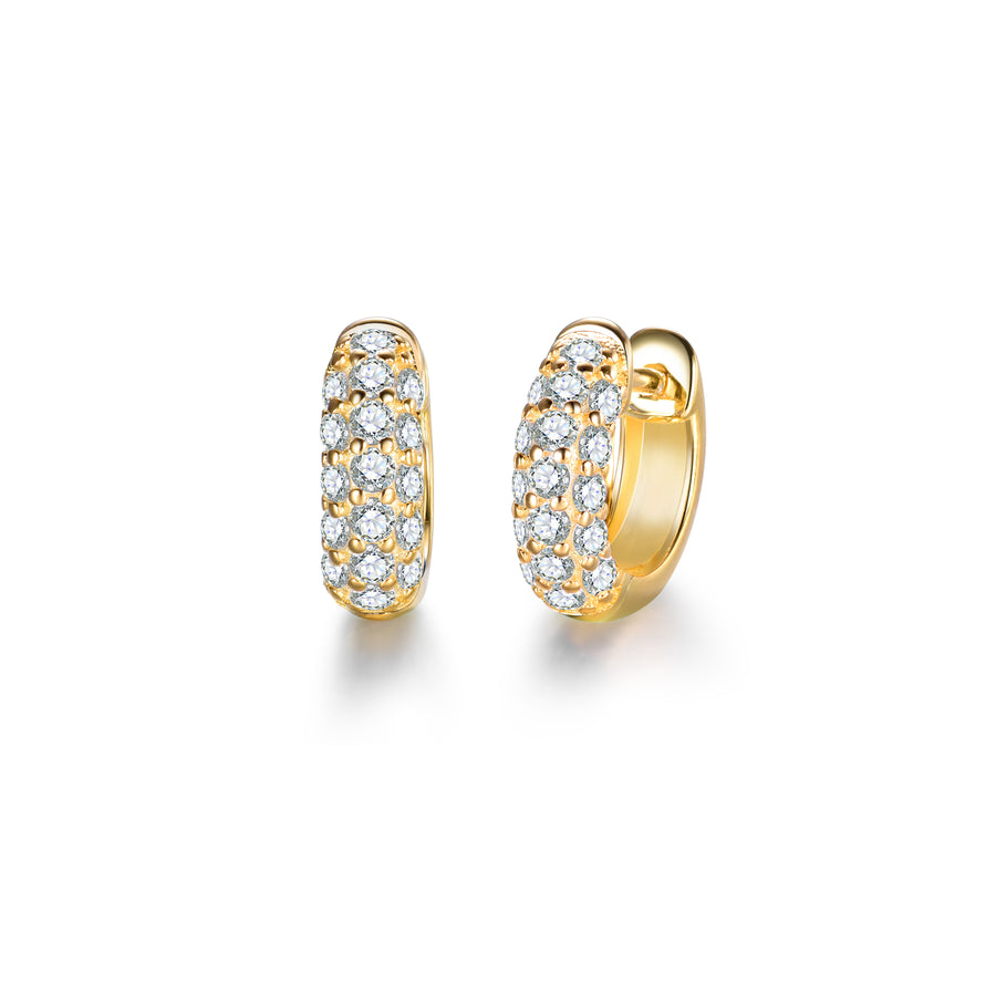 a pair of small, gold earrings made of pave cubic zirconia stones