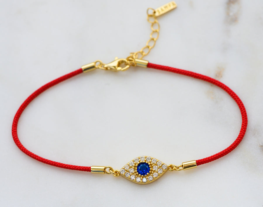 gold red string evil eye bracelet