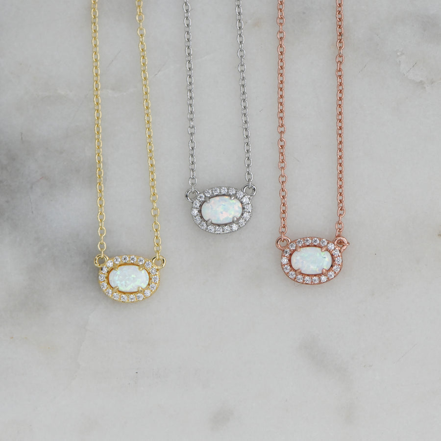dainty opal necklaces in gold, silver, and rose gold