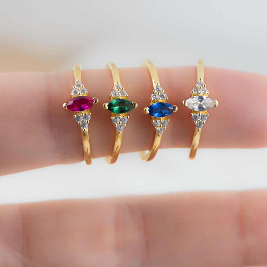 ruby, emerald, sapphire, and white cz marquise rings