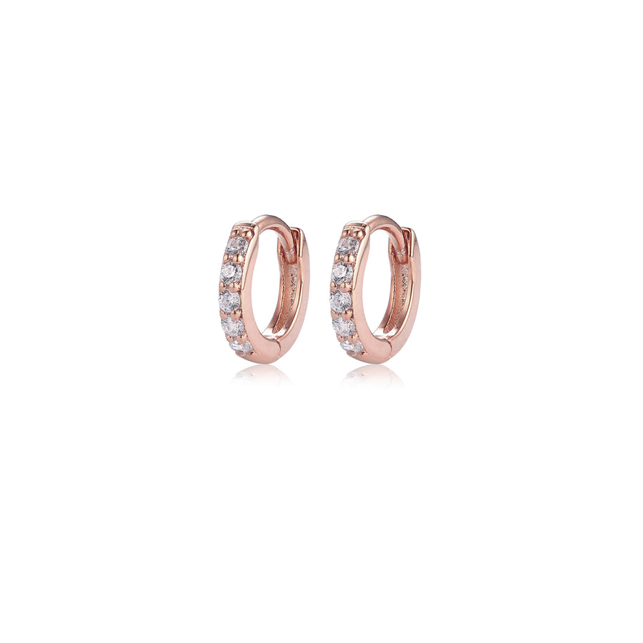 a pair of rose gold pave huggie hoop earrings