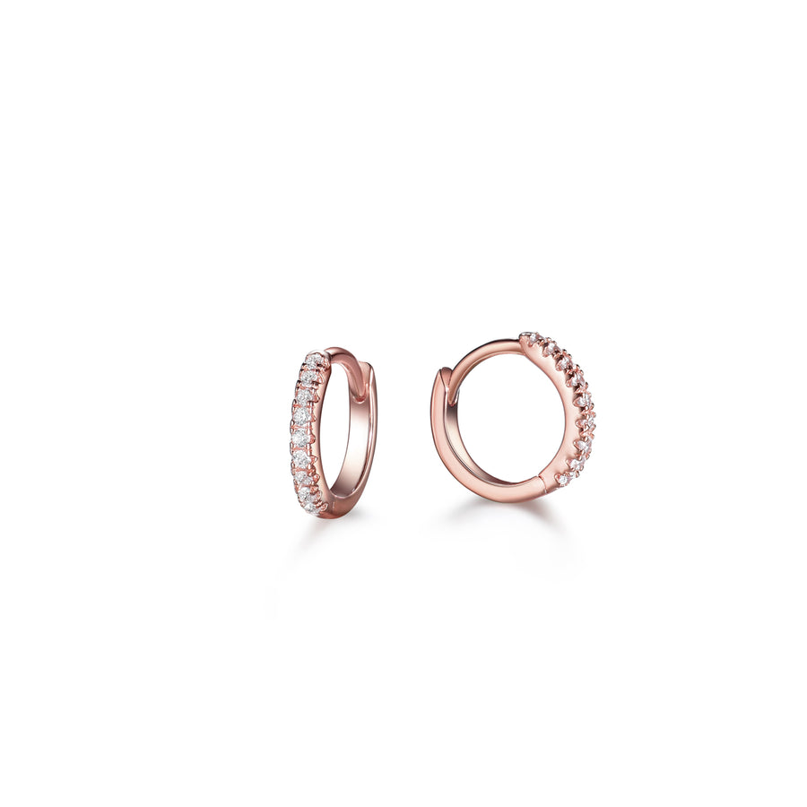 a pair of rose gold small hoop earrings made of pave cubic zirconia stones