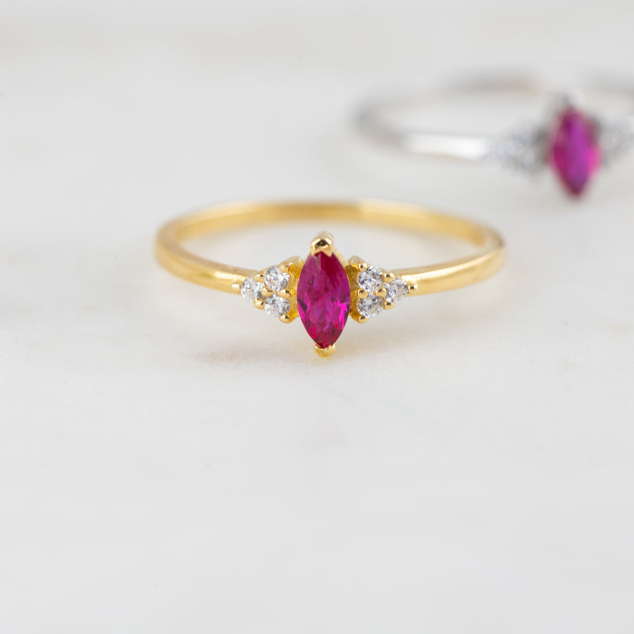 ruby with cz on the sides marquise ring