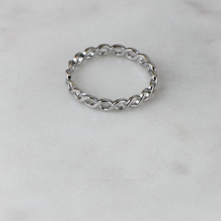 silver eternity band with an eternity pattern throughout