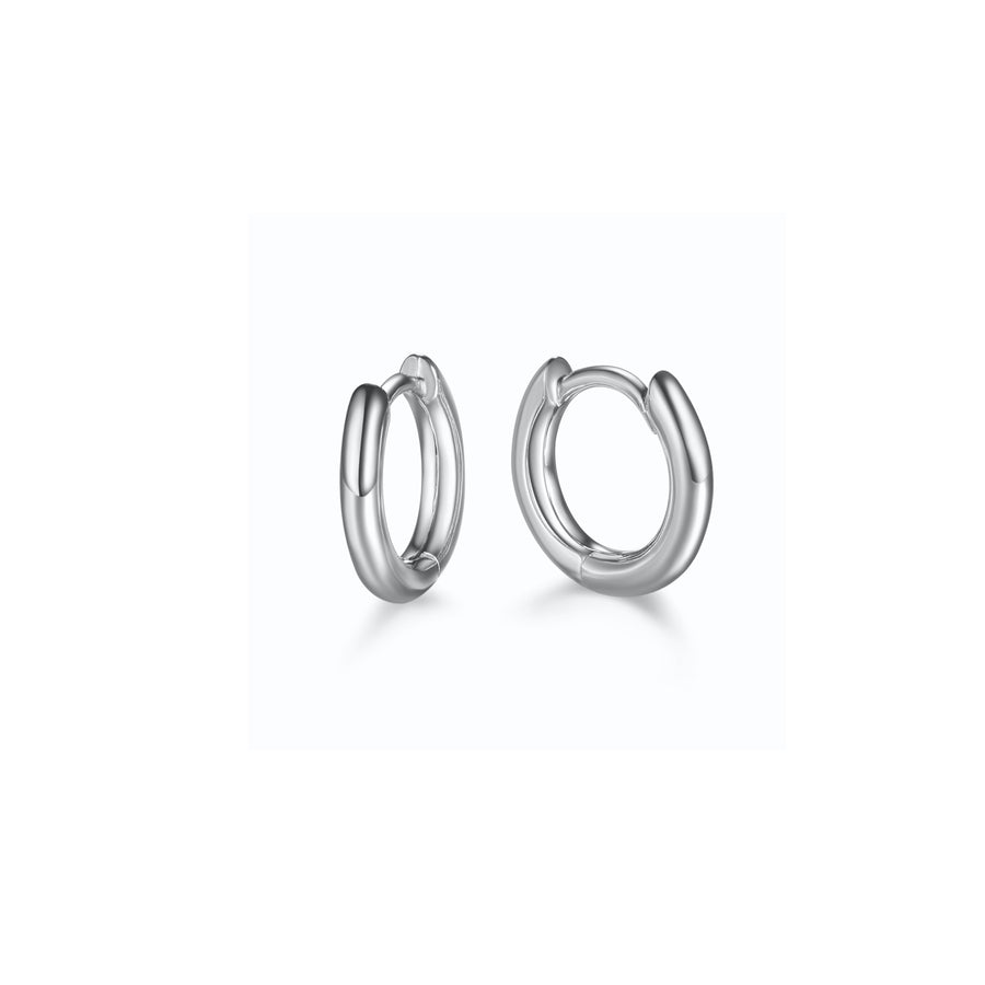 a pair of silver, huggie style hoop earrings