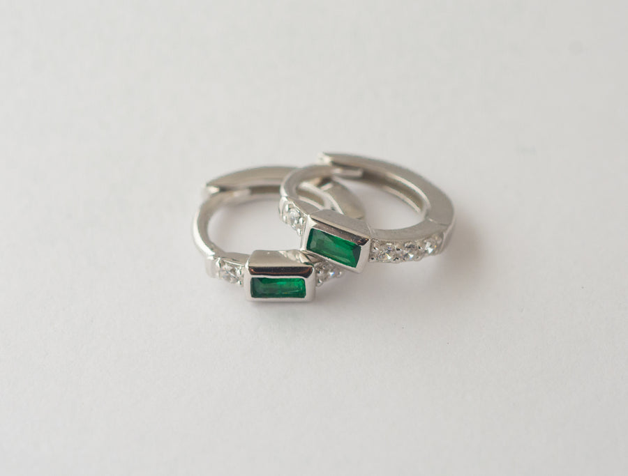 silver emerald baguette huggie hoop earrings