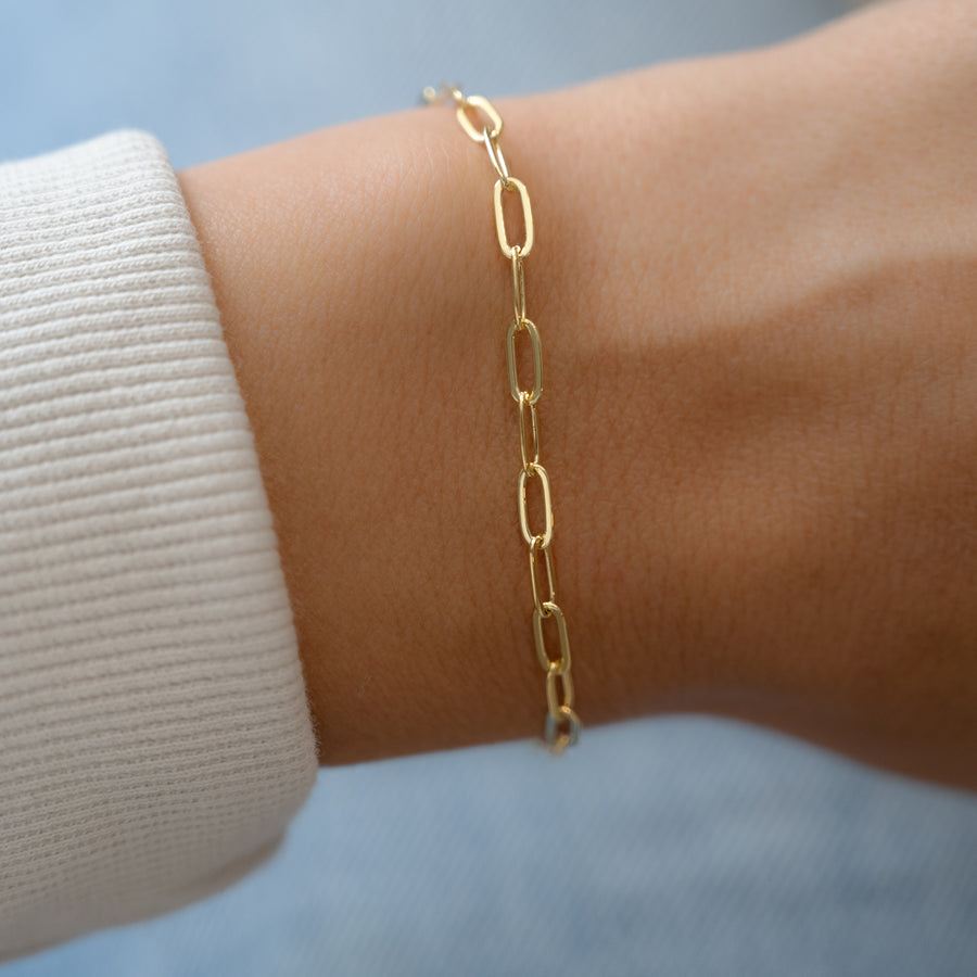 stacking small gold paperclip bracelet
