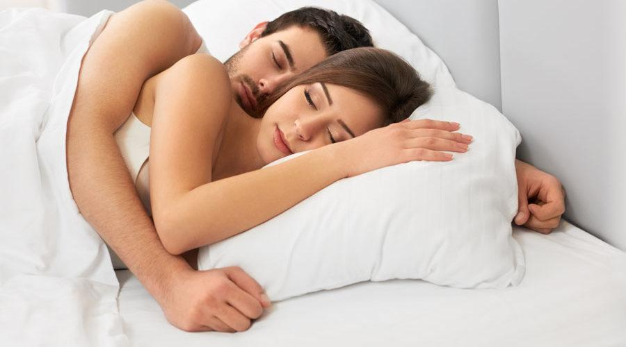 Couple sleep on bed