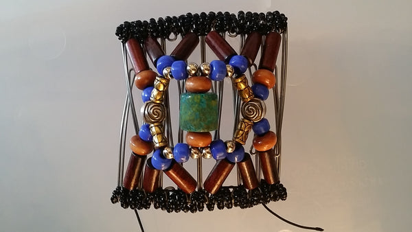 Wood, beautiful blue glass pony beads and turquoise center bead