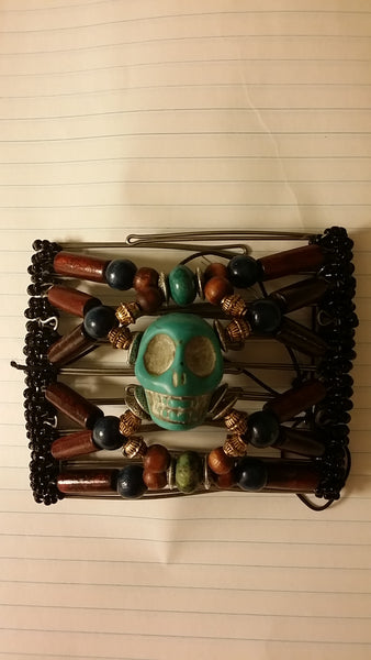9 tooth wood beads and turquoise skull center pendant
