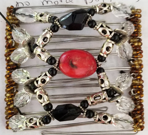 9 tooth  great for medium to thick hair. Black and silver. Real coral center!