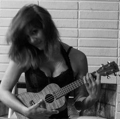 Michele Uke strums while we enjoy her latest blog